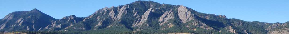 Banner Image of the Boulder Flatirons on a clear Fall day.