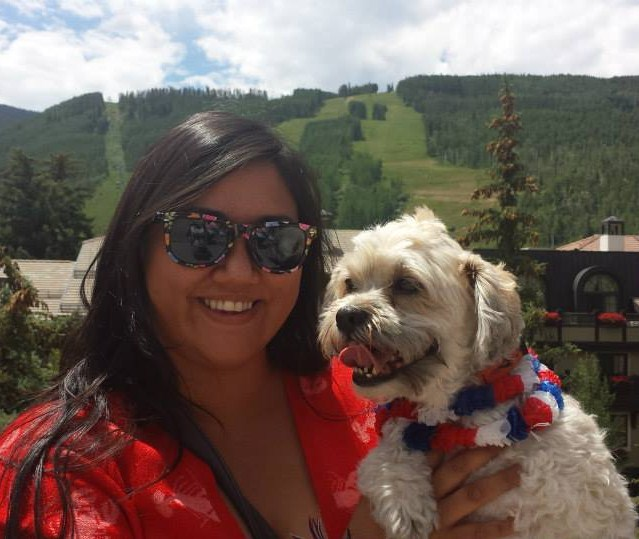 Photo of Jackie Lamaire, Children's Worship Pastor, at a ski area in the summertime with her dog.