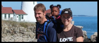 Banner photo of the Stryd's walking with their children with the sea and light house behind them.
