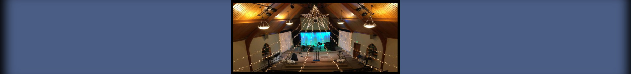 Banner photo of sanctuary decorated for Christmas.